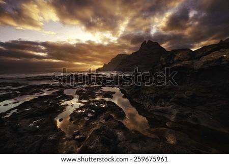 Colorful sunset over Punta del Hidalgo, Tenerife, Canary Islands, Spain - stock photo