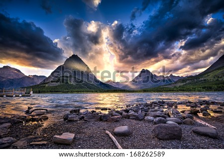 Colorful sunset over Swiftcurrent Lake in Glacier National Park, Montana - stock photo