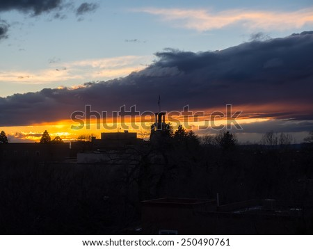 Colorful sunset over the cityscape in Santa Fe, NM - stock photo