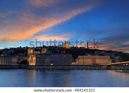 Colorful sunset over the Saone river and the Basilique Notre-Dame de Fourviere in the city of Lyon, France.