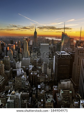 colorful sunset over the skyline of Manhattan - stock photo