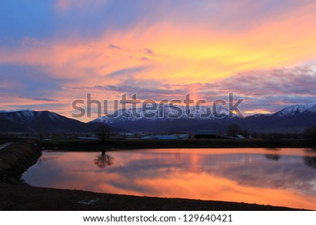 Colorful sunset reflection in Heber Valley, Utah, USA. - stock photo