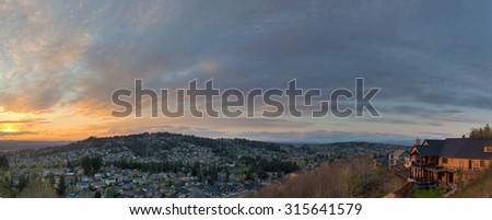 Colorful Sunset View Over Happy Valley Oregon Residential Suburbs Panorama - stock photo