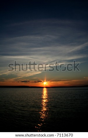 Colorful sunset with clouds - stock photo
