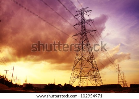 Colorful sunset with electric power stations. - stock photo