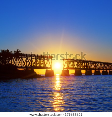 Colorful sunset with famous broken bridge, Keay West - stock photo
