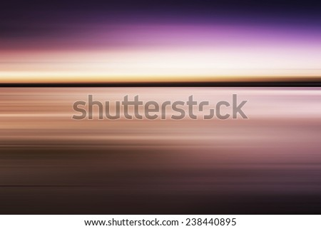 Colorful sunset with long exposure effect, motion blurred - stock photo