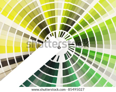 colorful swatch book with shades of green with a white label - stock photo