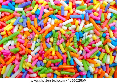 Colorful sweet background with colorful sprinkles. Holiday treat. Cupcake and Ice cream topping. Sweet Texture. Sweet Background - stock photo
