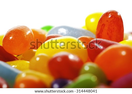 Colorful sweet Jelly Beans on white (neutral) background. Soft focus. - stock photo