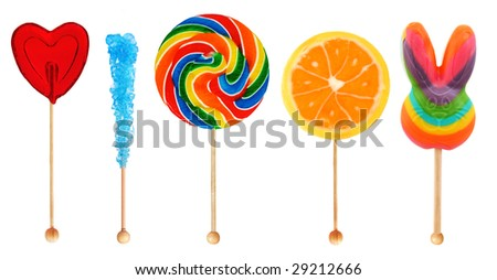 Colorful sweet lollipop candy in a row isolated on white - stock photo