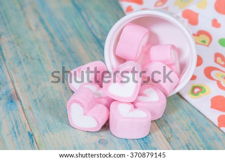 Colorful sweet marshmallow with sugar in a white-ware