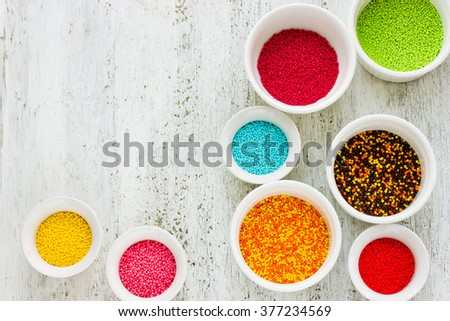 Colorful sweet sugar sprinkling set - stock photo