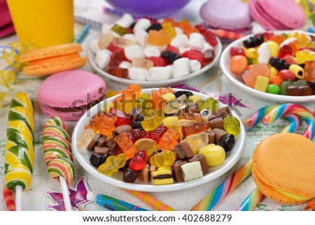 Colorful sweets and items for children's birthdays on a white background - stock photo