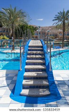 Colorful swimming pool in tropical resort district near Eilat - famous resort and recreational city in Israel