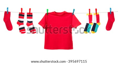 Colorful t-shirt and socks hanging on the clothesline. Image isolated on white background   - stock photo