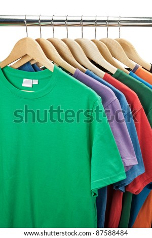 Colorful t-shirts on the hanger - stock photo