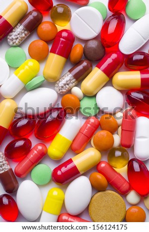 Colorful tablets and pills background - stock photo