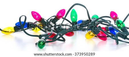 colorful tangled christmas lights on white background - stock photo