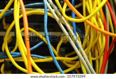 Colorful tangled ethernet computer wires - stock photo
