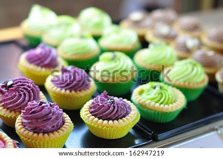 Colorful tarts selling in shop. - stock photo