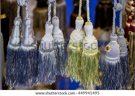 Colorful tassels for curtains. - stock photo