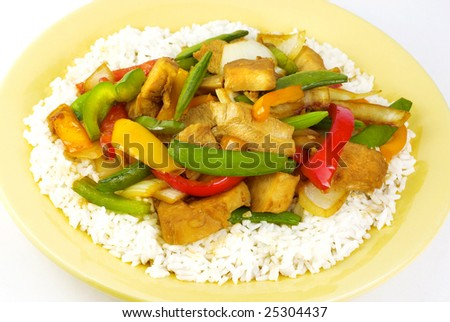 """Colorful teriyaki chicken with peppers, onions and """"snow peas"""" on white rice - stock photo"""
