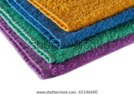 Colorful terry towels stacked up isolated on white