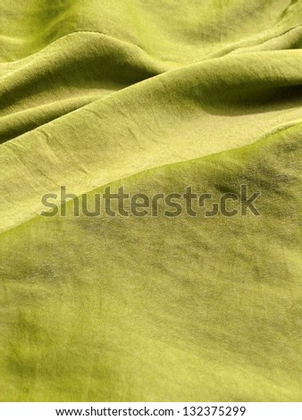 Colorful textile close up in bright yellow green.More of this motif and more textiles in my port. - stock photo