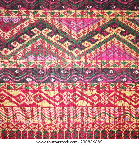 Colorful thai handcraft peruvian style rug surface old vintage torn conservation Made from natural materials Chemical free close up.  - stock photo