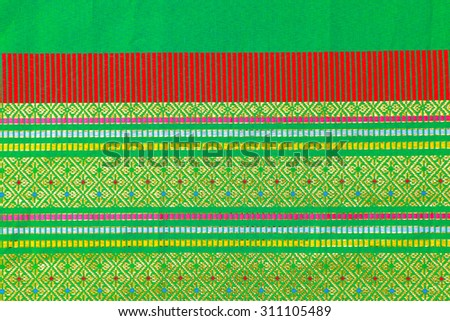 Colorful thai silk handcraft textile texture or background - stock photo