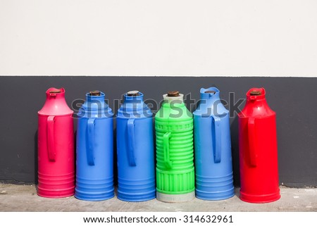 Colorful thermos flask from plastic for hot drinks - stock photo