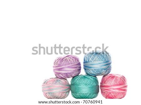 Colorful thread balls, white isolation. - stock photo