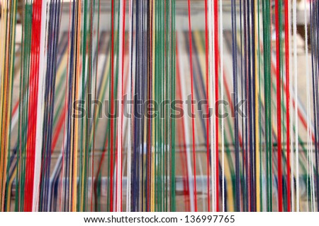 Colorful thread for clothes weaving - stock photo