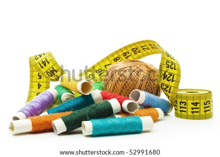 colorful thread with yellow measuring tape isolated on white - stock photo
