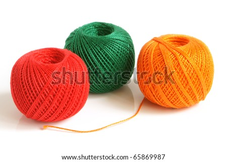 Colorful threads on a white background - stock photo