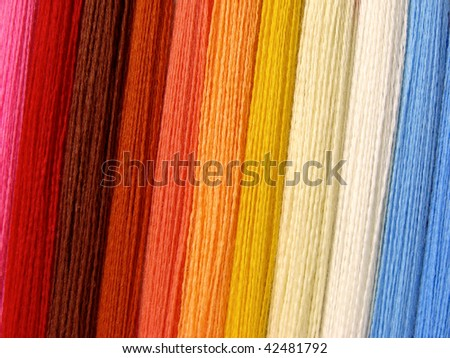 colorful threads set as a background - stock photo