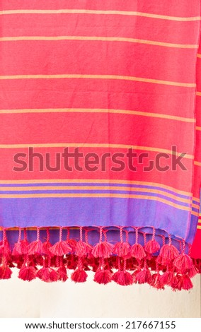 Colorful throws hanging in a store - stock photo