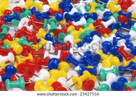Colorful thumb tacks close-up - stock photo
