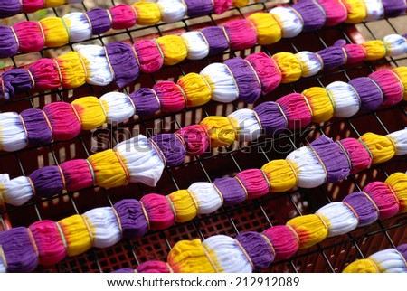 colorful tie dye cloth on rack - stock photo