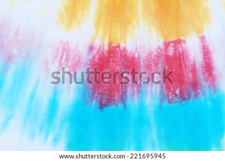 colorful tie dyed fabric for background.