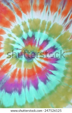 colorful tie dyed pattern on cotton fabric for background.