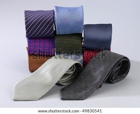 Colorful ties rolled up and placed in rows and stacks. - stock photo