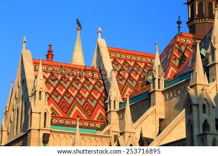 Colorful tiles decorate the roof of St Matthias catholic church in Budapest, Hungary - stock photo
