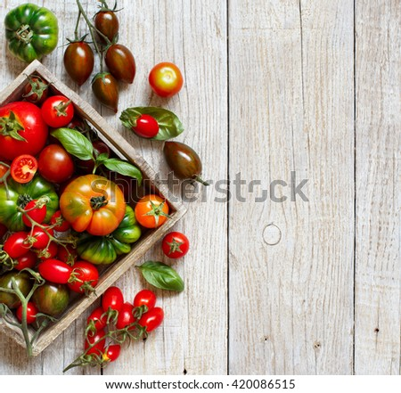 Colorful tomatoes on a wooden table top view