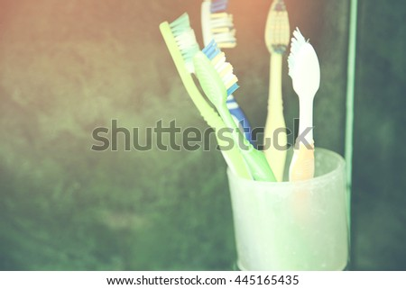 Colorful tooth brush in glass Isolated - stock photo