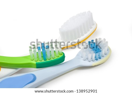 Colorful toothbrushes on white background with copy space. - stock photo