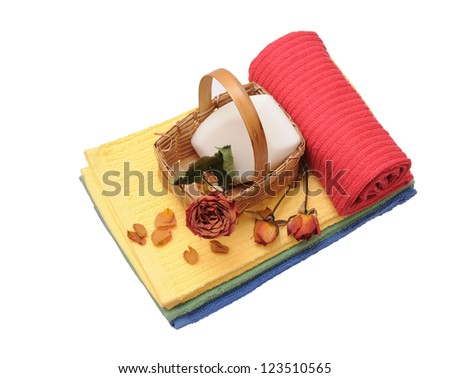 colorful towels and dried rose isolated on white background