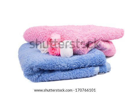 colorful towels and soap in the form of roses - stock photo