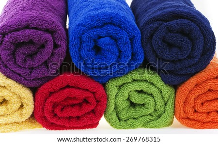 Colorful towels, cotton terry, rolled up.